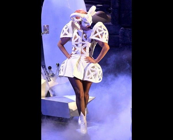 Lady Gaga wearing an abstract white bunny costume, complete with exaggerated shoulder