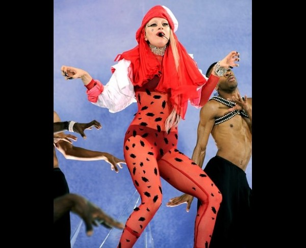 Gaga in a  a red leopard-printed Mugler outfit, white turban, and black booties